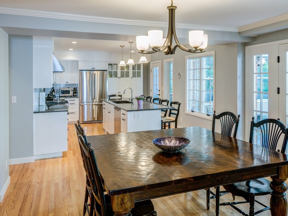 In this Ann Arbor Remodel  A classic Burns Park home gets a wide open  kitchen and dining room  combining charm and functionality  Removal of the  separating. Before   After   Rochman Design   Build