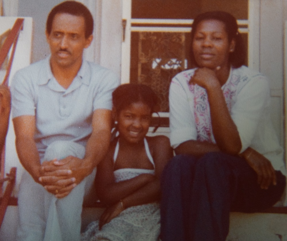 Me with my mom and dad wearing my one remaining bracelet.