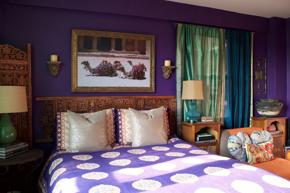 Bedroom by Helen Hamblin Designs (click on my portfolio page to see more):  The patterns, wood screen/headboard, sari curtains, art and decor makes this room quite worldly.