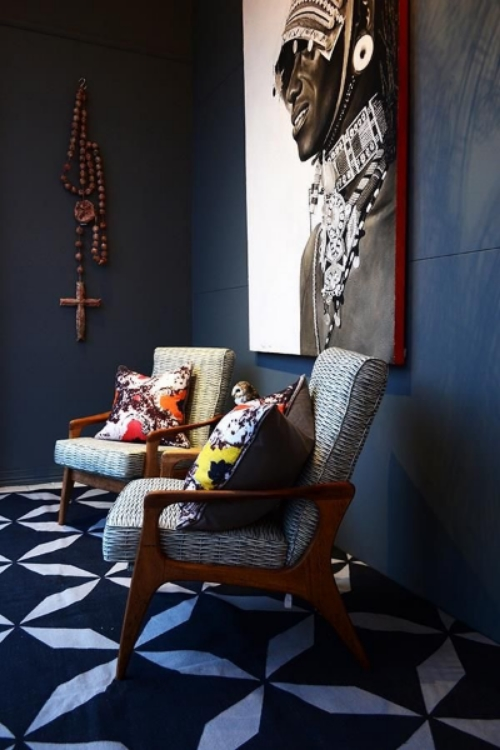 This vignette, chosen from the many interiors that inspire me on Pinterest,is worldly because of the bold patterns, textures, wood beads and that fabulous art!  (Click on picture to go to link)