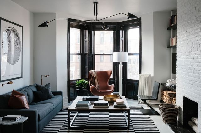 This eclectic room I chose from my Pinterest page mixes contemporary and modern furniture and lighting beautifully. {Just an FYI totally off topic, I hate seeing more than two stacks of books on a table! There are so many other items that can be used when styling and putting the decor details together! That is the one thing I would change in this interior.} (Click picture to go to link)