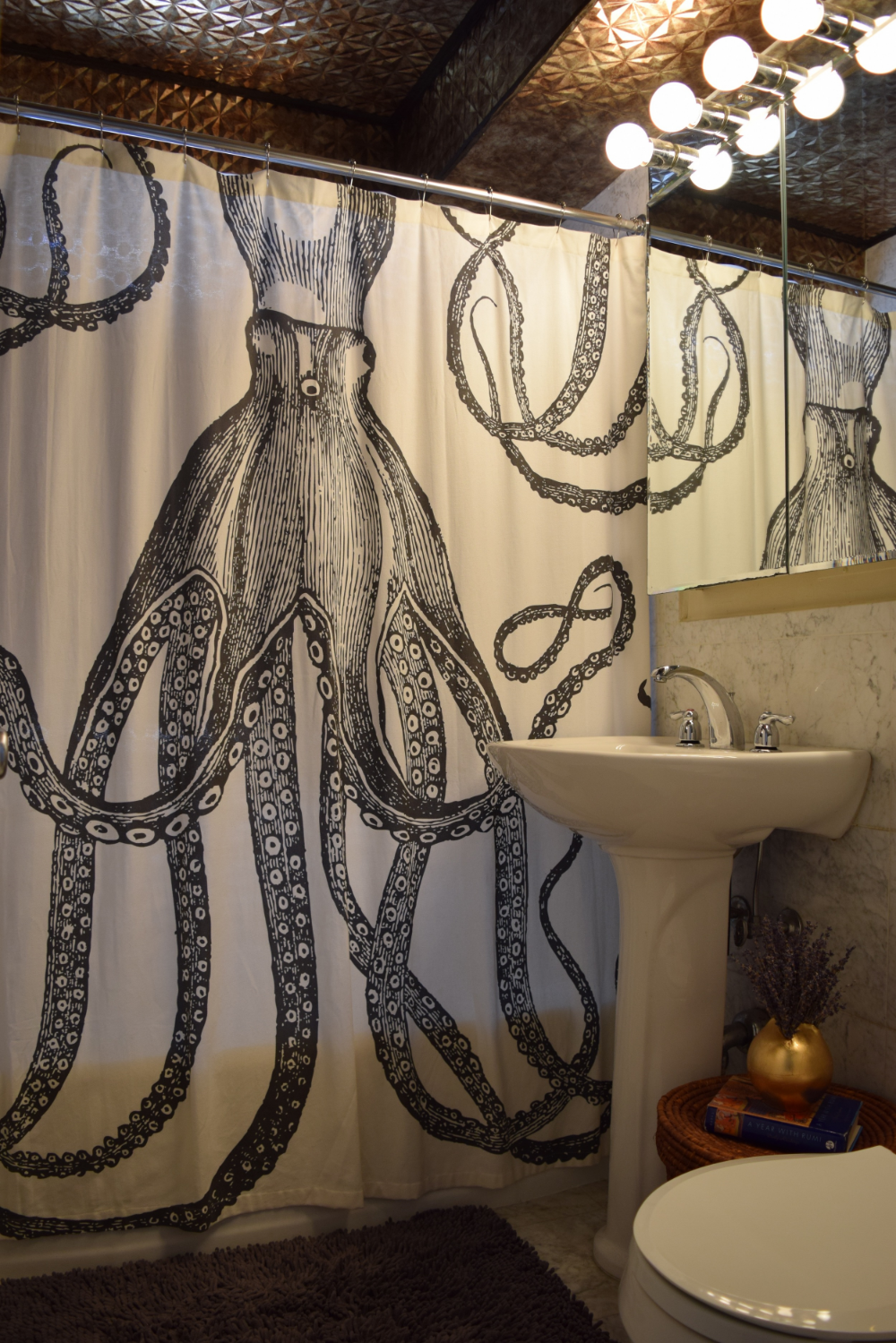 Bathroom by Helen Hamblin Designs - Bold and whimsical shower curtain from Anthropologie, and check out that beautiful ceiling!  (Click on my portfolio page to see more)