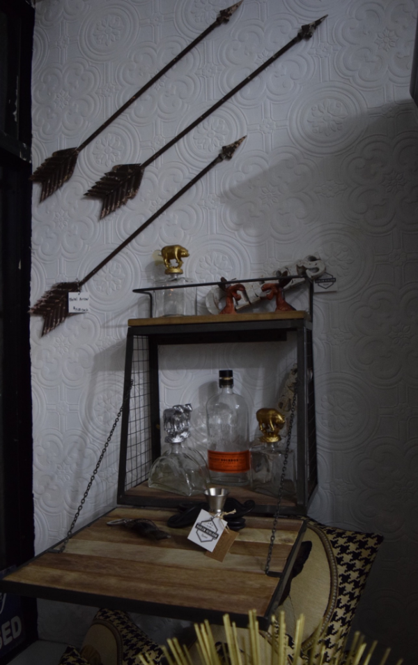 How cute is this little wall bar?  (It doesn't have to be a bar by the way, you can put anything on the shelves, but I love the idea of using it this way!)  The animal decanters are great too!  And let's not ignore those cool arrows.
