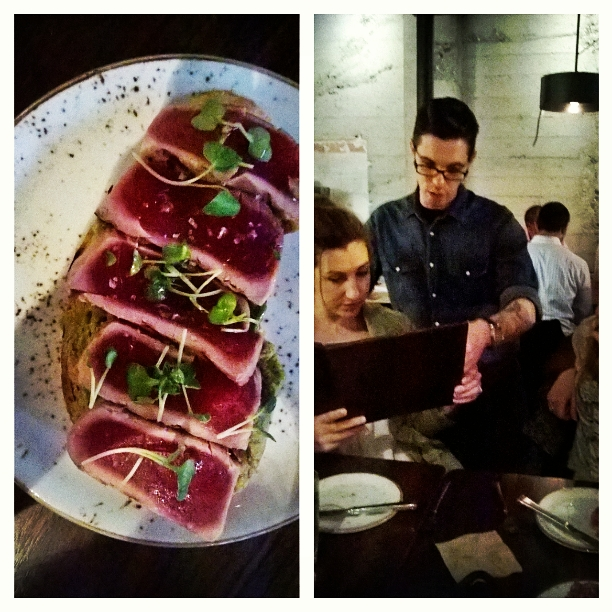 Seared ahi tuna and server at Miller's Guild discussing menu options.