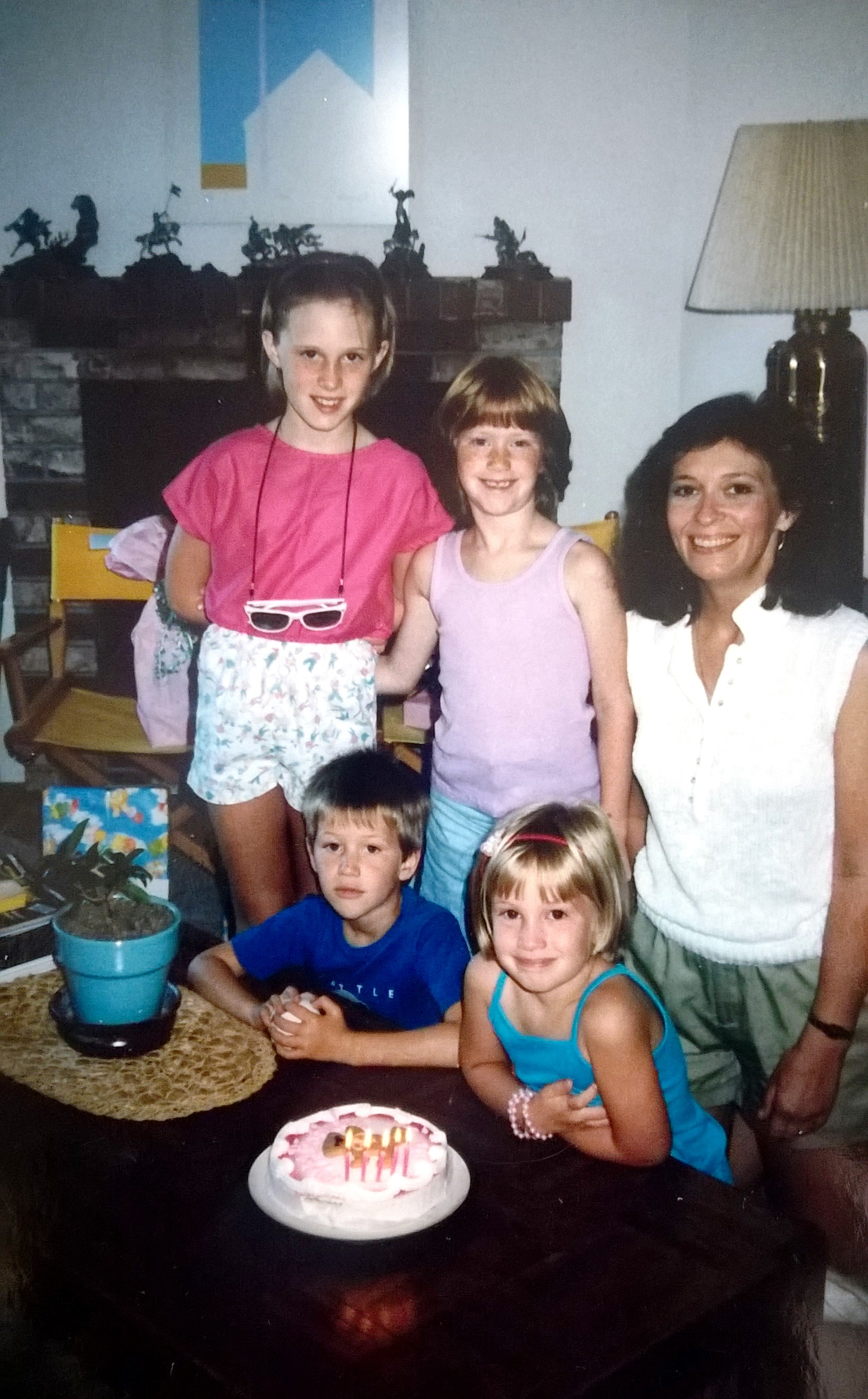 On my 5th birthday I was a cake-loving, shy, close-mouthed smile girl. We've come a long way, baby! But, Lord, look at those fabulously '80s outfits we all have. And also, I'd like to note that my mom is still this beautiful, so I'm REALLY lucking out in the gene pool. Of note: my mom is 38 years old in this picture. (I KNOW!!!!!)