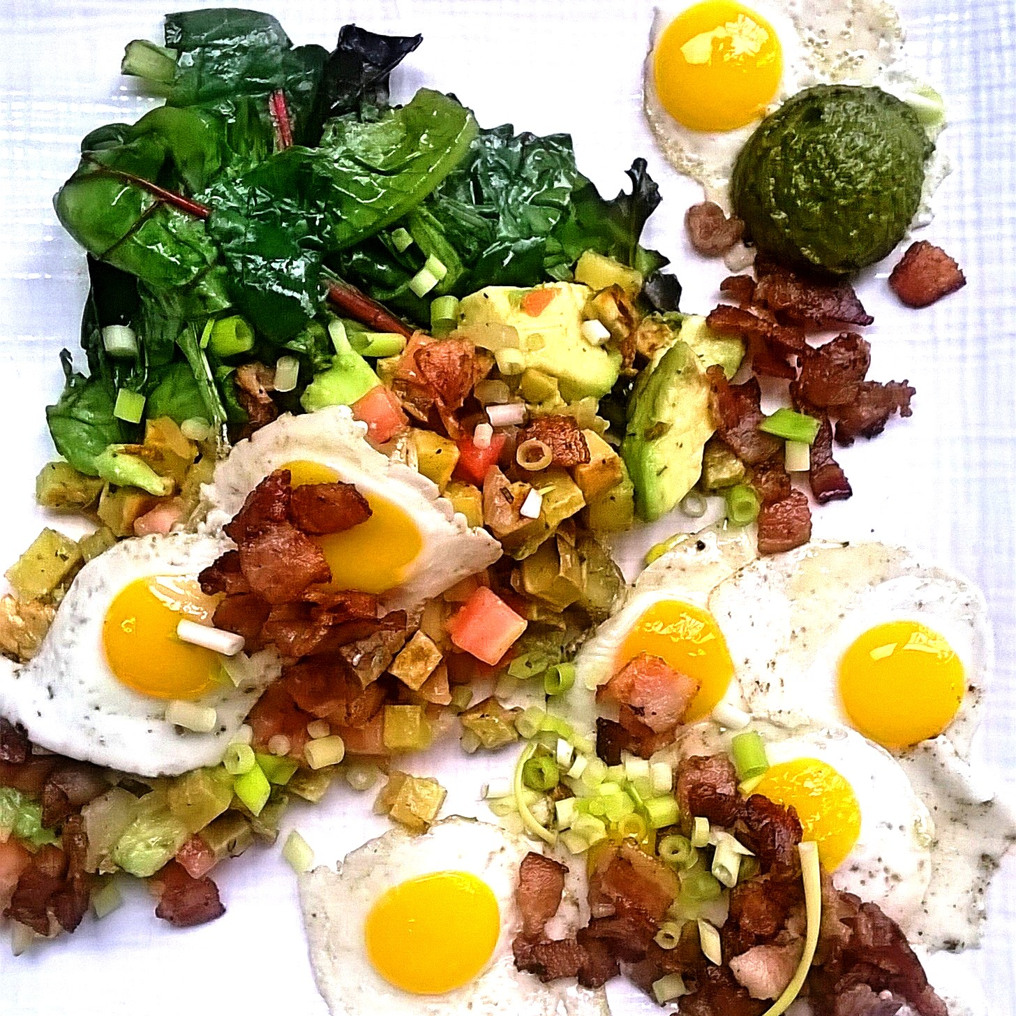 Brunch with quail eggs, sweet potato hash and chimichurri