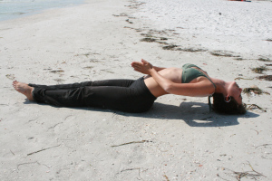 Fish pose is great for opening the heart, relieving lower back pain, stretching the internal organs, abdominals and hips, strengthening the back and improving posture. Be sure to put the top of your head on the ground so as not to strain your neck. If this is hard for you, just put your elbows down by your side for support.