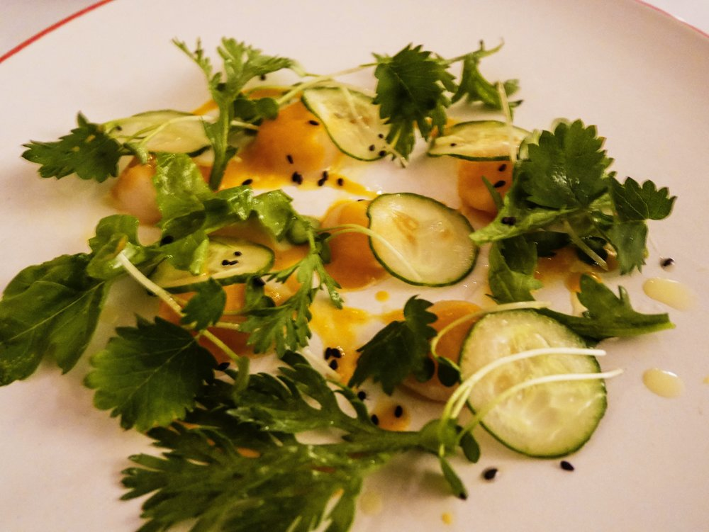 Fermented ají amarillo with cucumbers and herbs