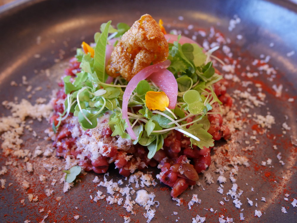 Barroo in Los Angeles, CA - Farro and kamut cooked with koji beet creme and dashi with nuts and rose apple pickle.