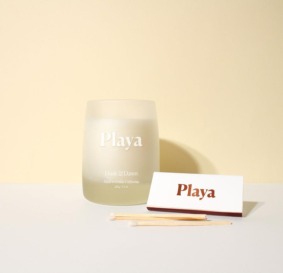 PLAYA BEAUTY - DUSK AND DAWN CANDLE - If you want to give someone the gift of their home smelling like the beach 24/7, get them this. Playa Beauty has just released their signature product scent in a candle and its incredible! This comes with the candle & match sticks. This product is limited edition so if you are thinking about it, just go for it! Sadly, couldn't get a coupon code for this, but orders over $50 get Free Shipping.