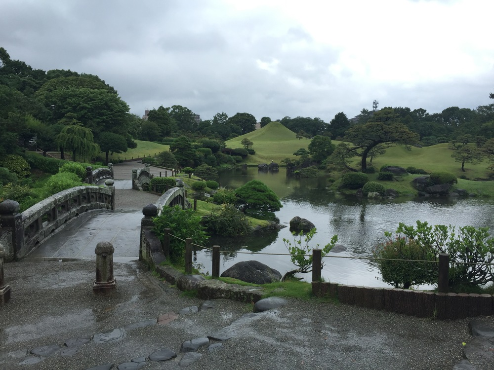Suizenji Jojuen is a traditional Japanese garden full of bridges, koi ponds, bonsai trees, and shrines