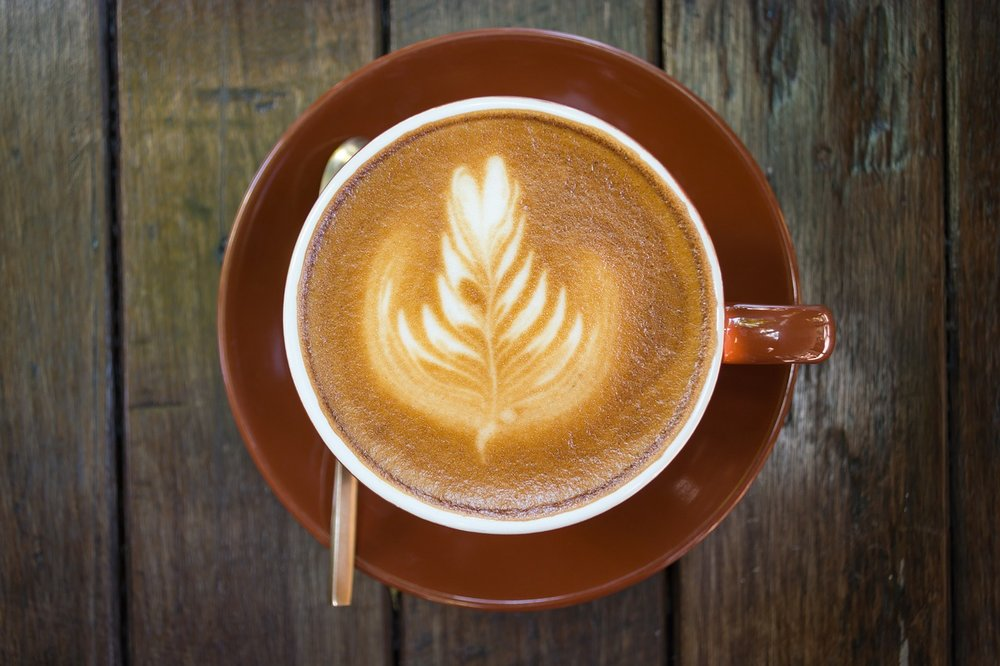 Your dependence on coffee may lead to an obsession with local hipster coffee shops and taking pictures of that work of art. (Image Courtesy of Pixabay)