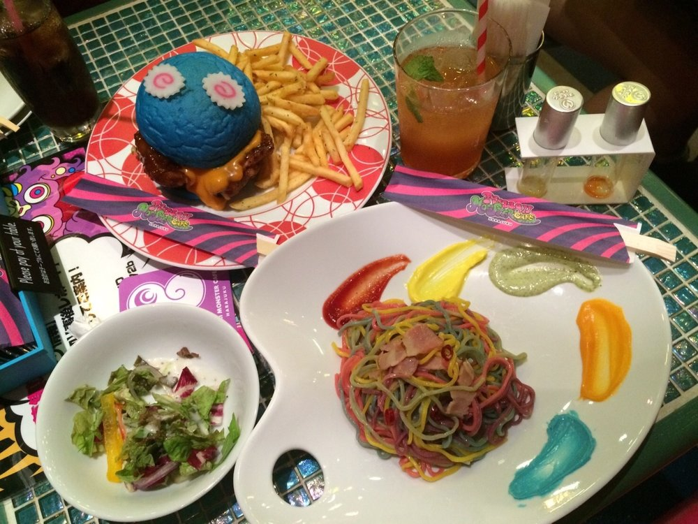 An order of a blue teriyaki chicken burger and rainbow-colored pasta.