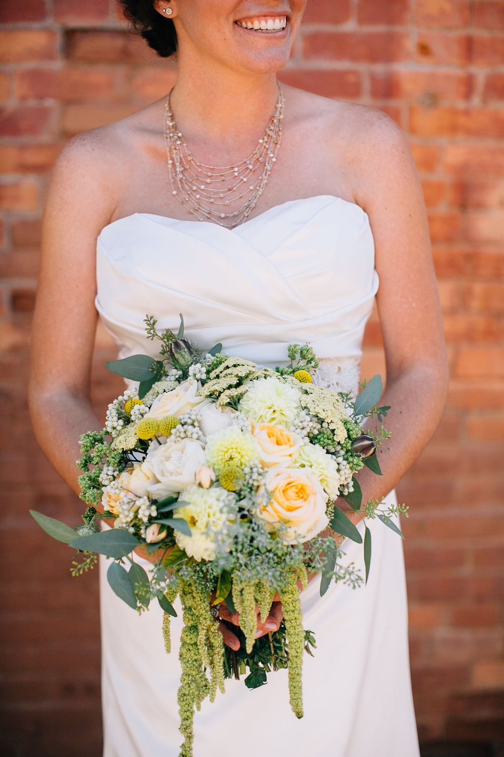 Bride Holding her Bouquet Designed by Kate Healey