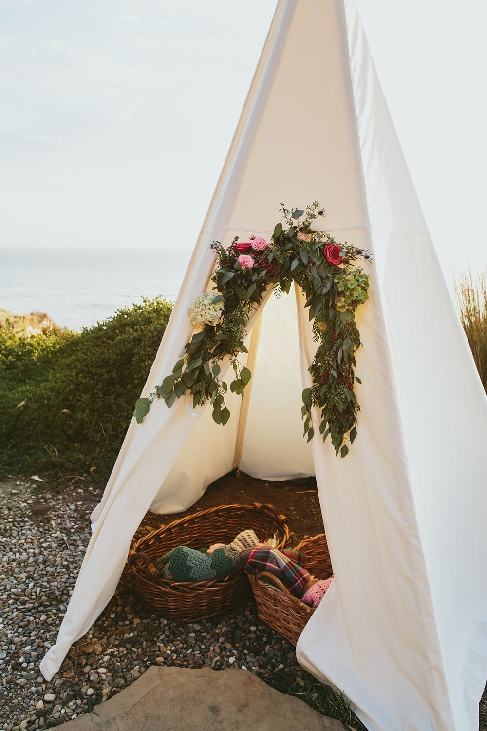 Decorative Teepee and Flower Garland by Kate Healey of Big Sur Flowers