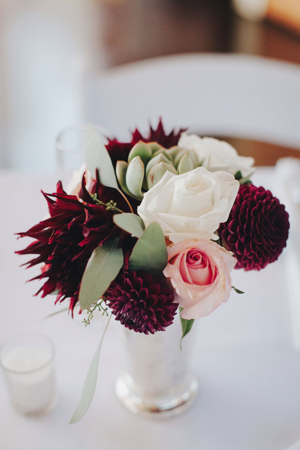 Wedding Table Flowers with White and Pink Roses created by Kate Healey