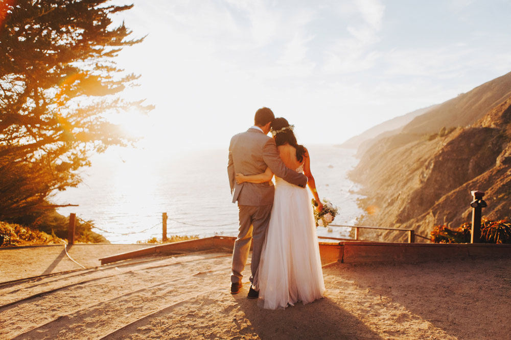 Bride and Groom Holding Each Other by the Ocean