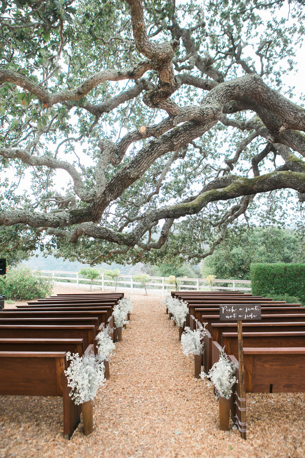 Outdoor Ceremony Pews Decorated by Big Sur Flowers
