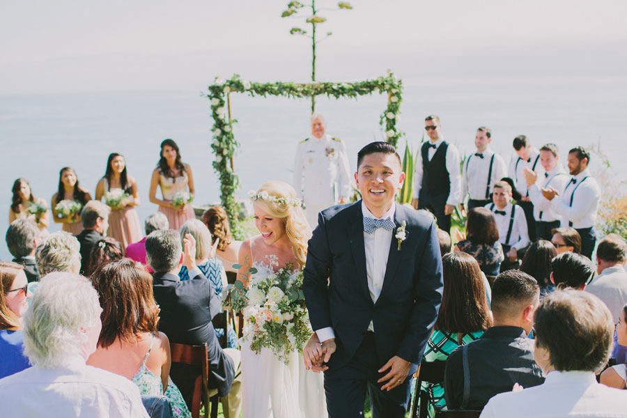 Wedding Arch and Bridal Bouquet Adorn a Point 16 Ceremony Site