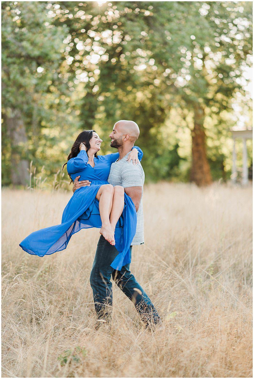 Romantic Discovery Park Seattle engagement photo in long blue lulus dress in the wild fields | Julianna J Photography | juliannajphotography.com