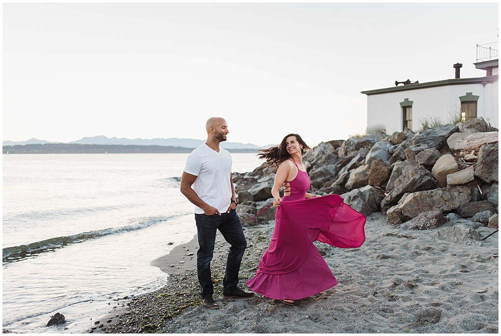 Fun and Romantic Discovery Park Seattle engagement photo by the lighthouse with lulus fusion dress | Julianna J Photography | juliannajphotography.com