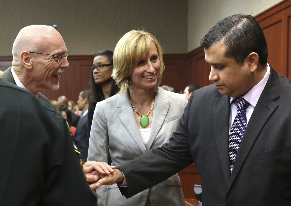 George Zimmerman is congratulated by his defense team after being found not guilty in the shooting death of Trayvon Martin at the Seminole County Criminal Justice Center in Sanford Florida