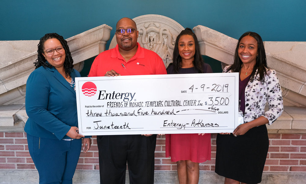 FMTCC President Martie North Hamilon (second from right) with treasurer Jay Hartman present a check from Entergy Arkansas to MTCC Director Christina Shutt (left) and Development Director Jaimie Wright.