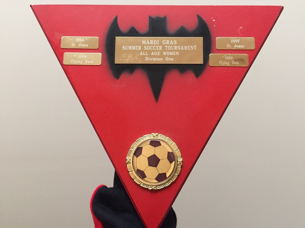 PHOTO: FLYING BATS 2016. MARDI GRAS SUMMER SOCCER TOURNAMENT SHIELD. ST JOANS WIN 1996 and 1997. FLYING BATS WIN 1998 and 1999.