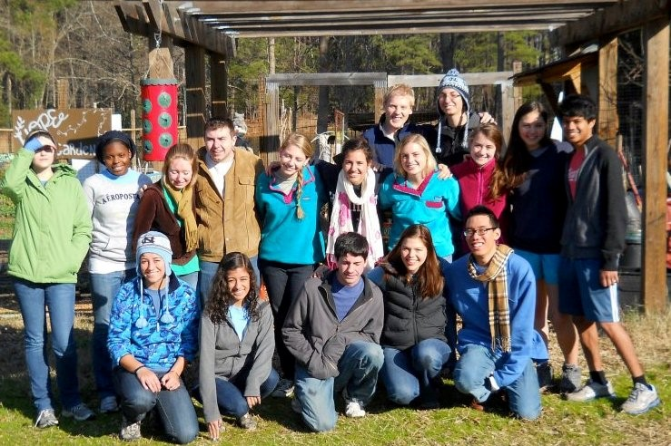 Hope Staff and Volunteers at the garden gate.