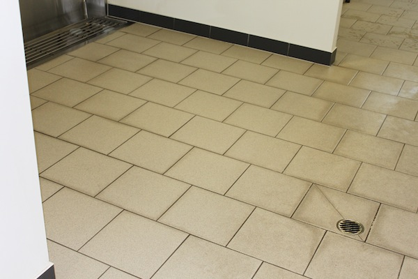 Cleaning bathroom tiles after the Just Professional 3 step cleaning process