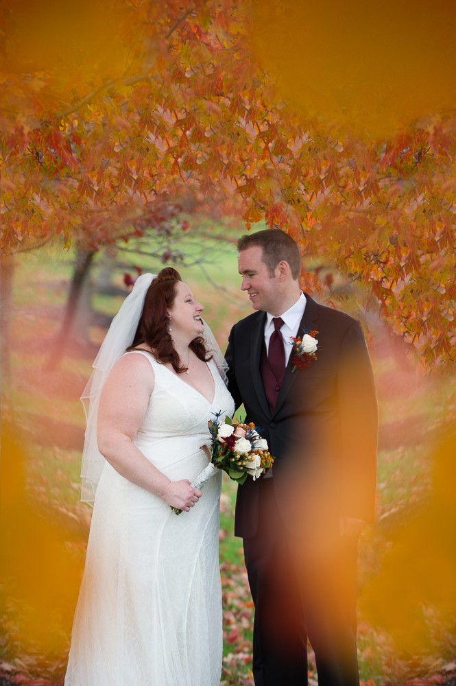 2-dayton-wedding-fall-leaves-bride-groom-dominick-lofino-park.jpg