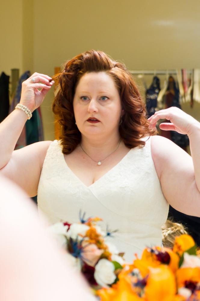 2-dayton-wedding-prep-bride-fixing-hair-st-luke-catholic-church.jpg