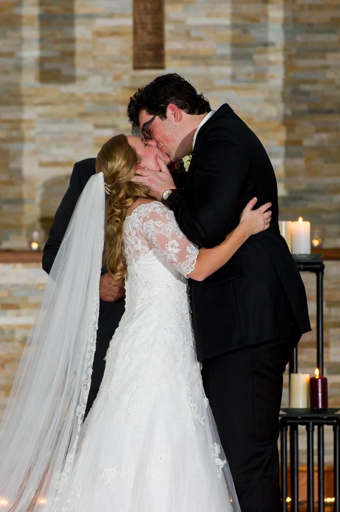 3-cincinnati-wedding-lights-out-ceremony-first-kiss-faith-bible-church.jpg