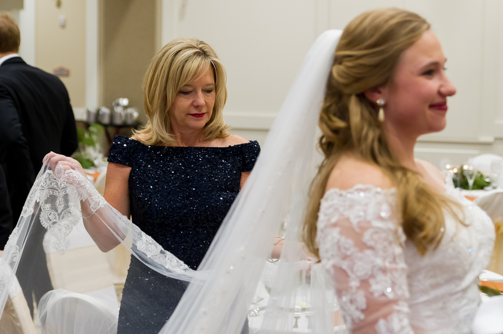 3-cincinnati-wedding-mother-fixing-veil-bride-cooper-creek-event-center.jpg