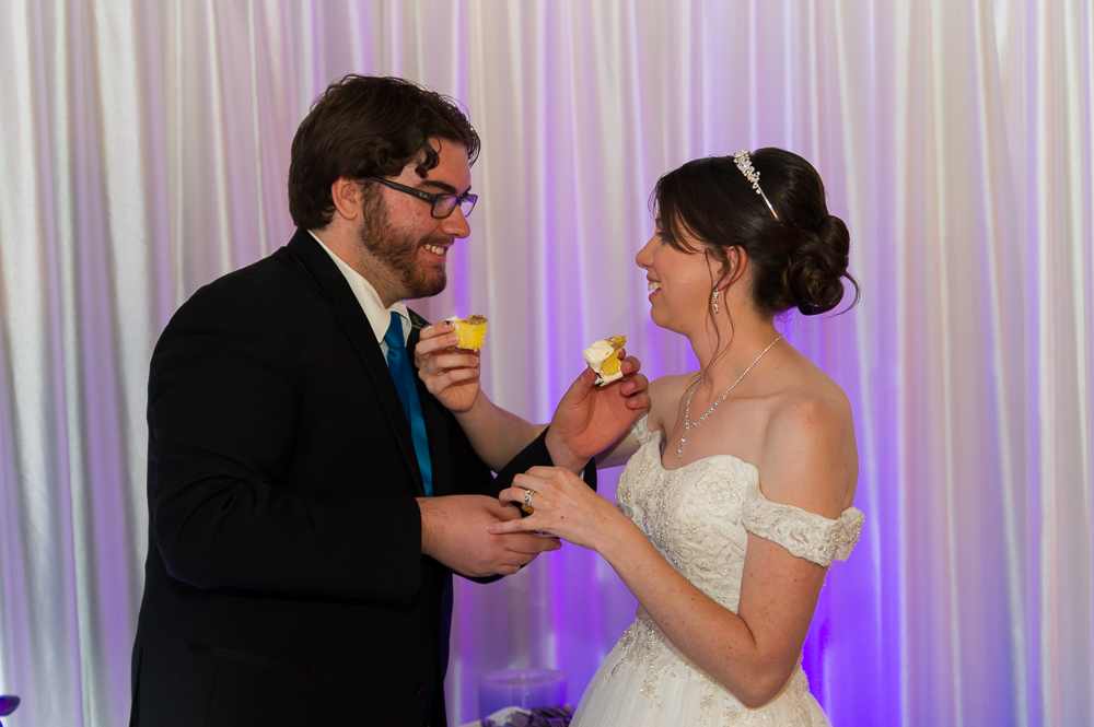 3-dayton-wedding-feeing-cake-bride-groom-event-connections.jpg