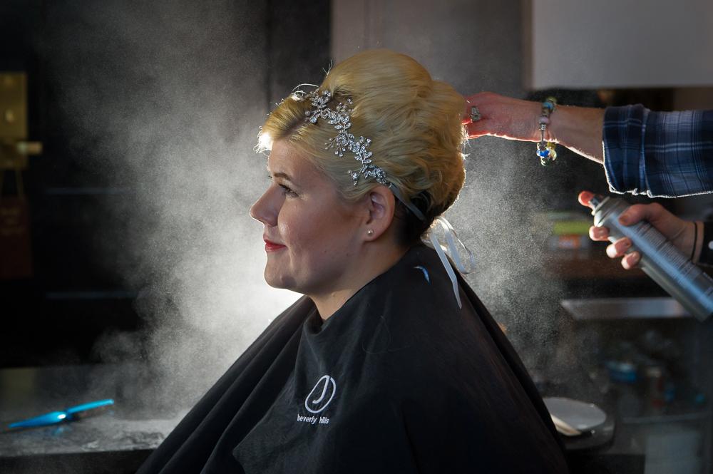 4-cincinnati-wedding-bride-prep-hair-spray-backlit-hotel-covington.jpg