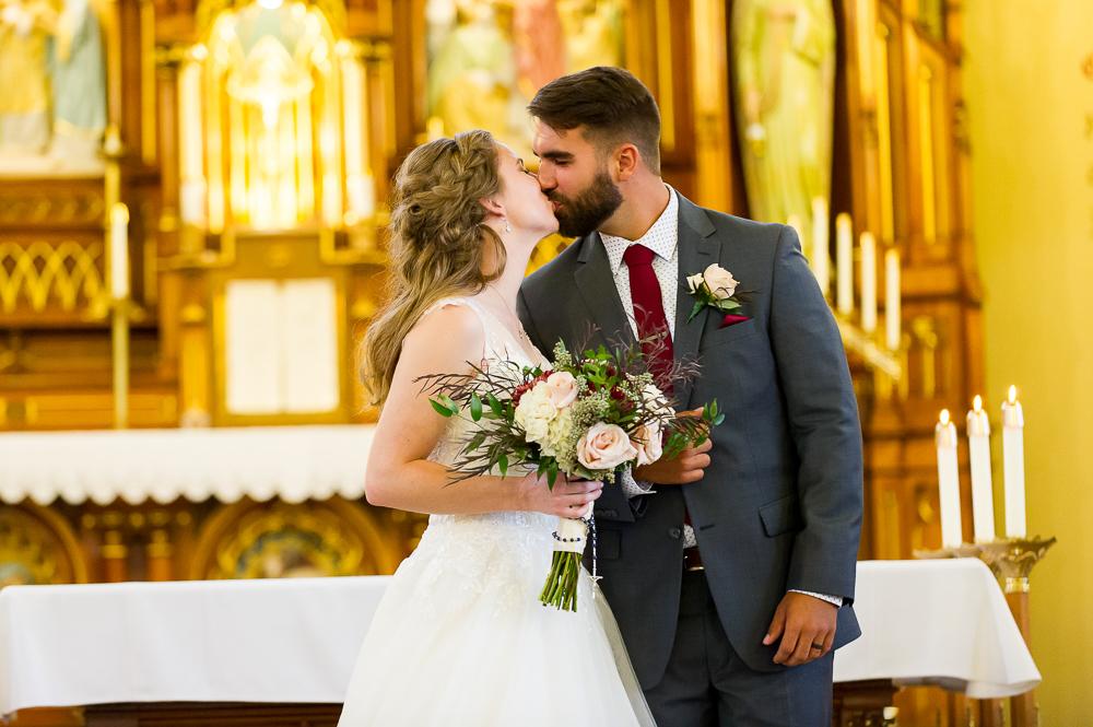 5-cincinnati-wedding-ceremony-first-kiss-holy-angels-catholic-church.jpg