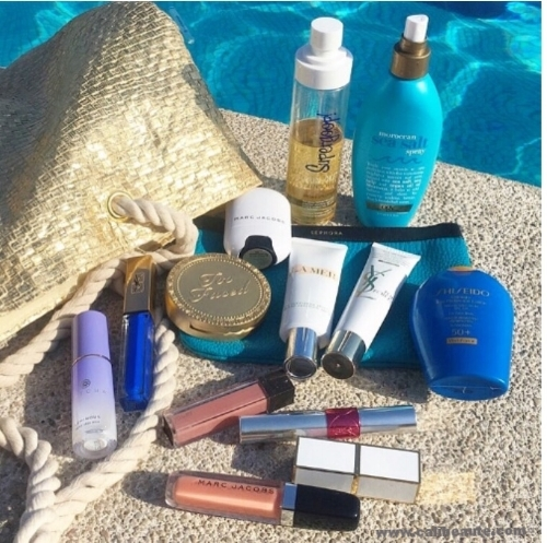 Pool side essentials include the Supergoop Sunscreen Oil.