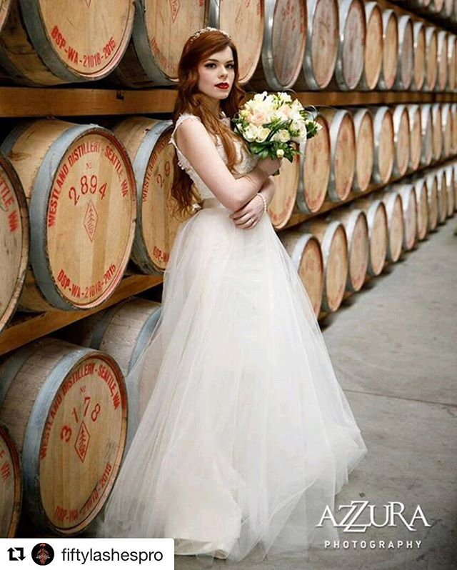 Gorgeous photo from the Westland Distillery at I Do Sodo!!😍 it was so fun to collaborate with all these wonderful people #belltownbride #belltownbrideseattle #bridalhair #bridalmakeup #idosodo #bridalparty #seattlephotographer #seattleevents #seattlebride #bridal #shesaidyes #seattlevenue #seattleflorist  #Repost @fiftylashespro with @repostapp ・・・ Wedding season is here... for model @baileydocter #FLSPRO chose a cranberry red lip paired with a classic lined eye... 💄💄💄... WHAT COLORS FOR LIPS ARE YOU THINKING OF FOR YOUR WEDDINGS? SHOUT THEM OUT, and tag your friends who are getting married...💄💄💄 Makeup bookings now available, visit my website to book... Photographer: @azzuraphotography #azzuraphotography Gown: @belltown_bride Hair: @jn_lp Lashes: @mysdlashes