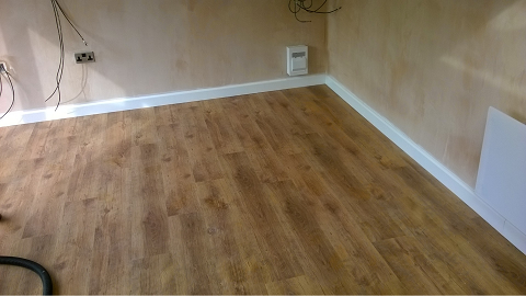Day 9 - Laminate flooring and skirting fitted, 2nd fix electrics completed -
