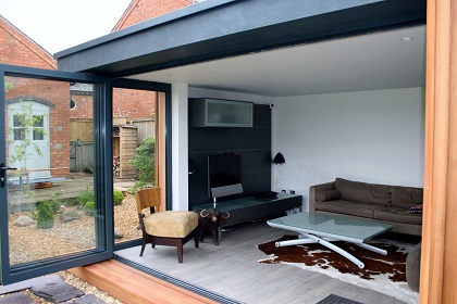 By using residential specification materials we ensure a luxury, quality feel to your new garden room space both on the inside and the outside. We have available as designs options high grade Cedar, Larch and Thermwood cladding finishes, aluminium & UPVC bi-folding doors in contemporary gray and black colours, quality laminate flooring, internal plasterboard and full skim finishes and recessed LED down-lights. All added to class leading thermal performance provides a luxury, quality feel.
