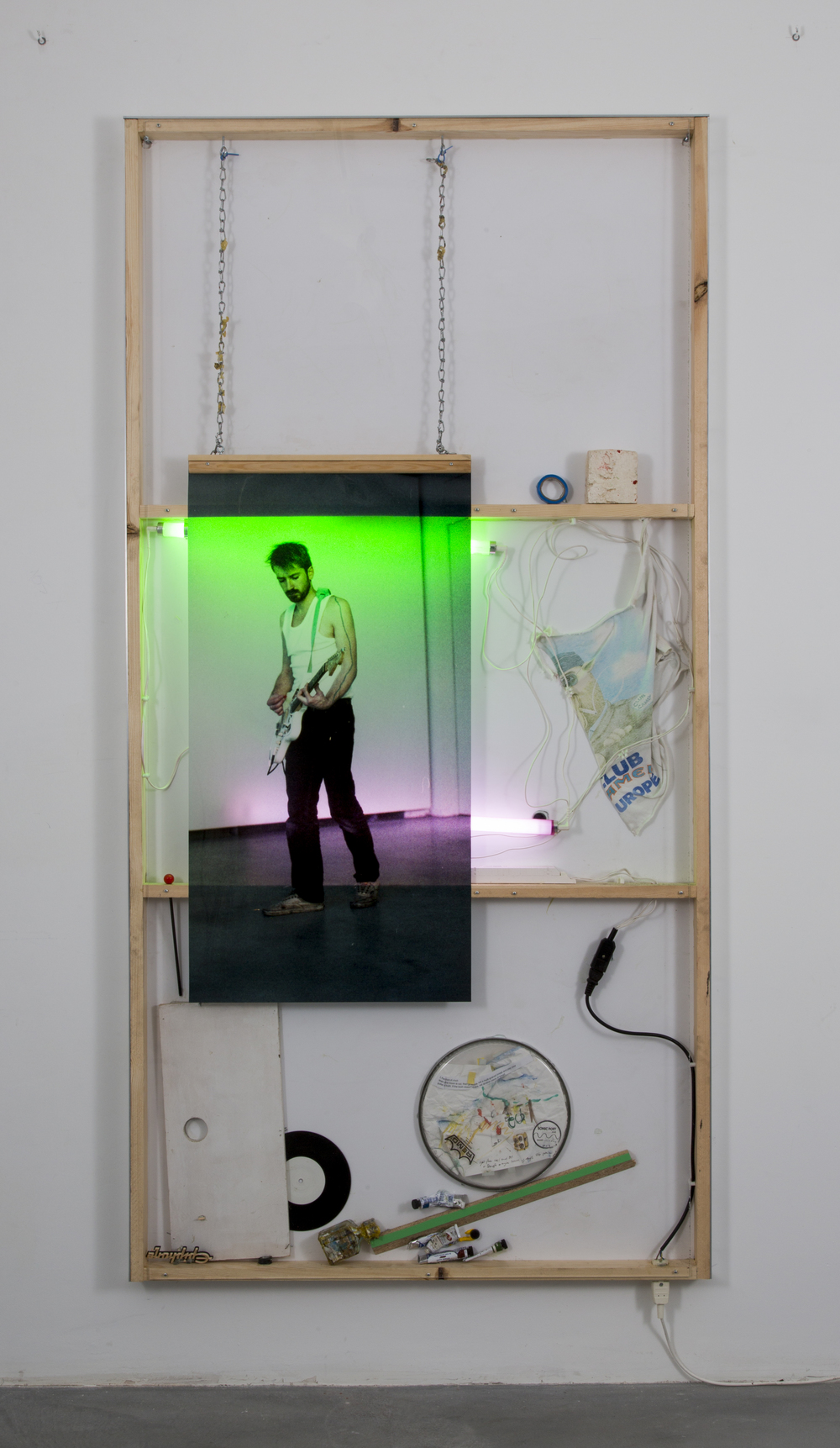 Joris Van de Moortel ,  The cyclic character of playing through a repetition of the same fragment, me, KB Berlin  (2015). 78.95 x 39.75 x 2.2 inches. Wood, Plexiglass, aluminum, printing on Duratrans, green and pink light-tubes, battery pieces, drawing on paper, vinyl, and various objects undefined. ( Photo :   ©   WE DOCUMENT ART)
