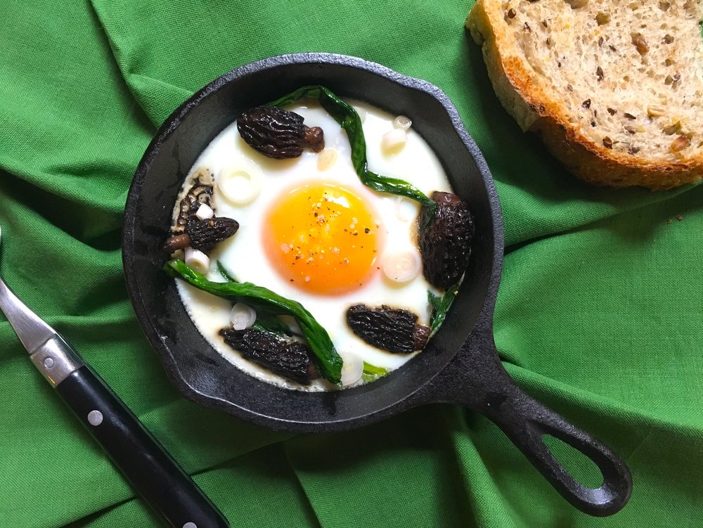 Baked eggs with ramps and morels
