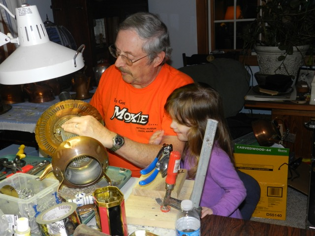 It's all in the family at Q & D!  David works on a feeder with his granddaughter.