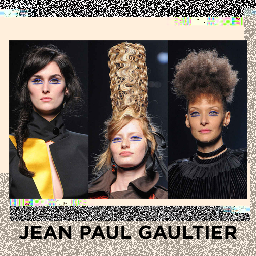 Jean Paul Gaultier's signature stripes snuck into the show, not on the designs but on the face - LOVE! Quite a few different hairstyles were delivered, our picks were the classic fishtail, this absolutely crazy, wiggly cage crown and the little cloud of an afro.