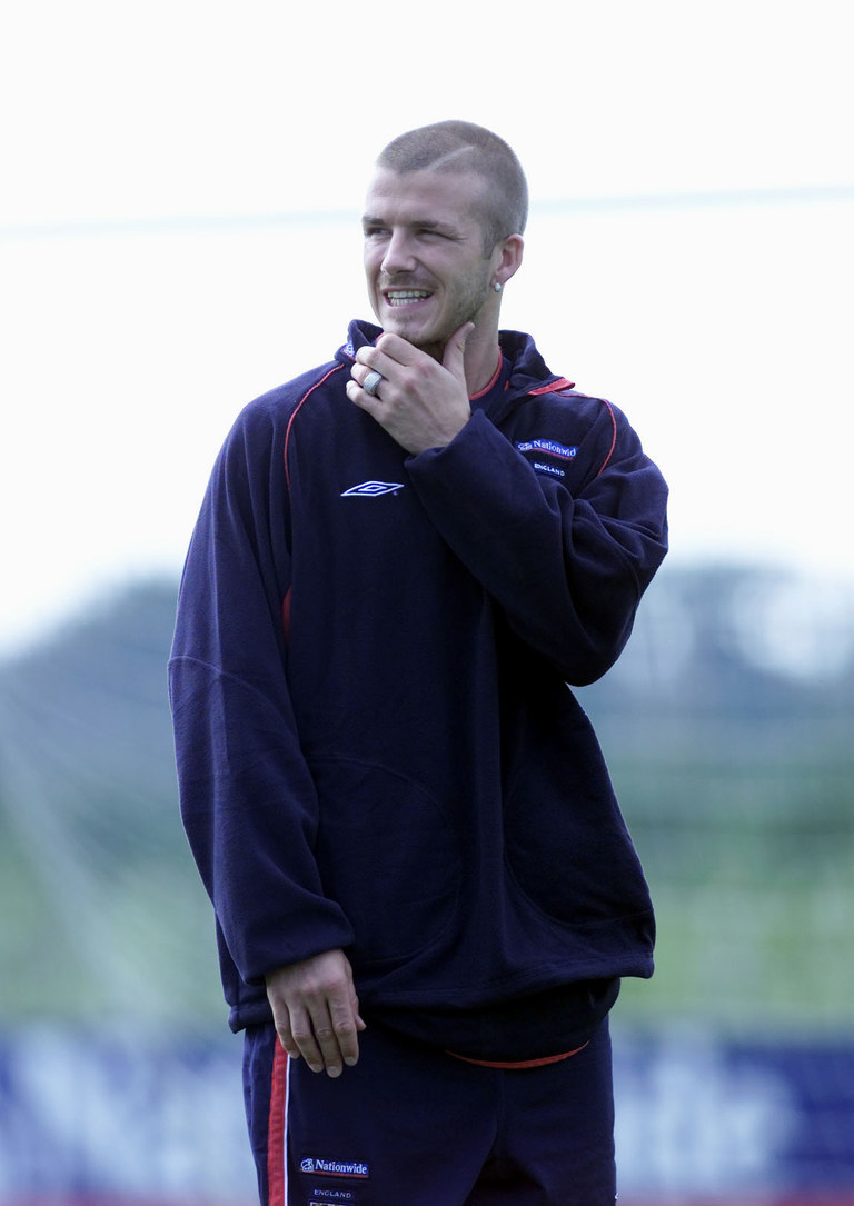 Beckham sports his trademark shaved head and asymmetrical forehead slit, August 2001. Getty Images