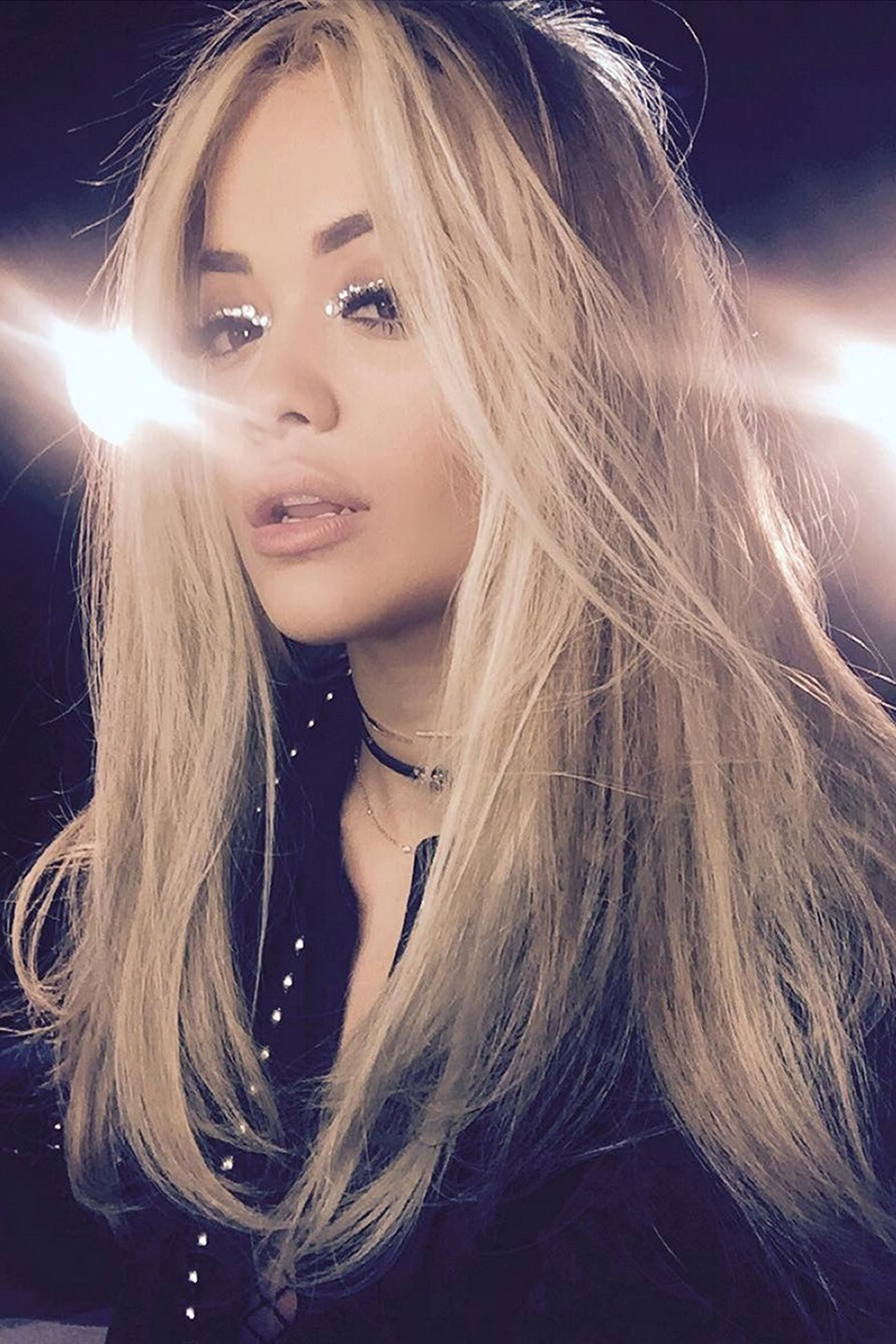 Rita Ora looks LUSH with a straight blow dry, glittery lids and a matte lip.