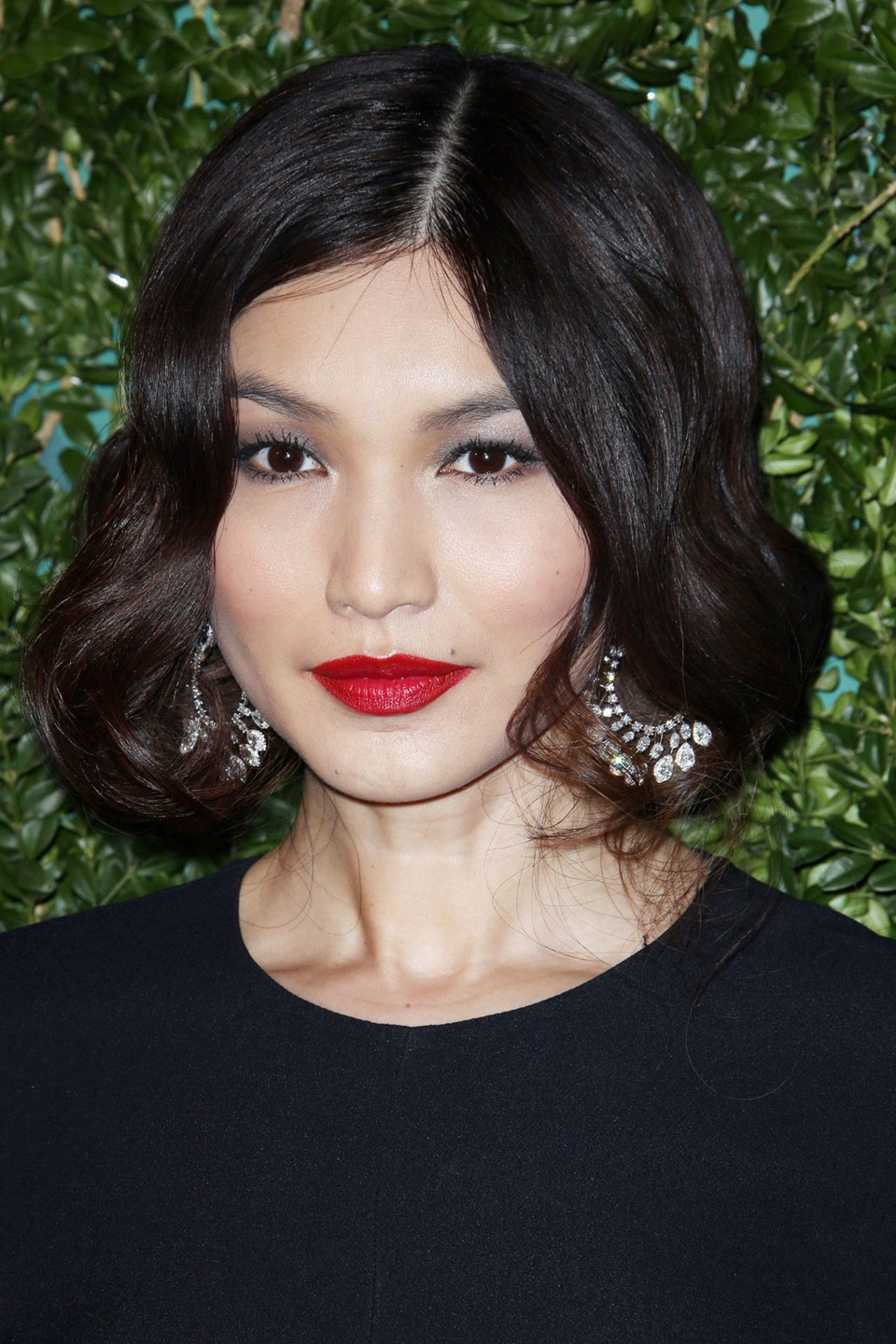 Fancy short hair for the party season without the commitment? Like Gigi Hadid, Gemma Chan has gone for a faux short style for retro appeal and added volume.