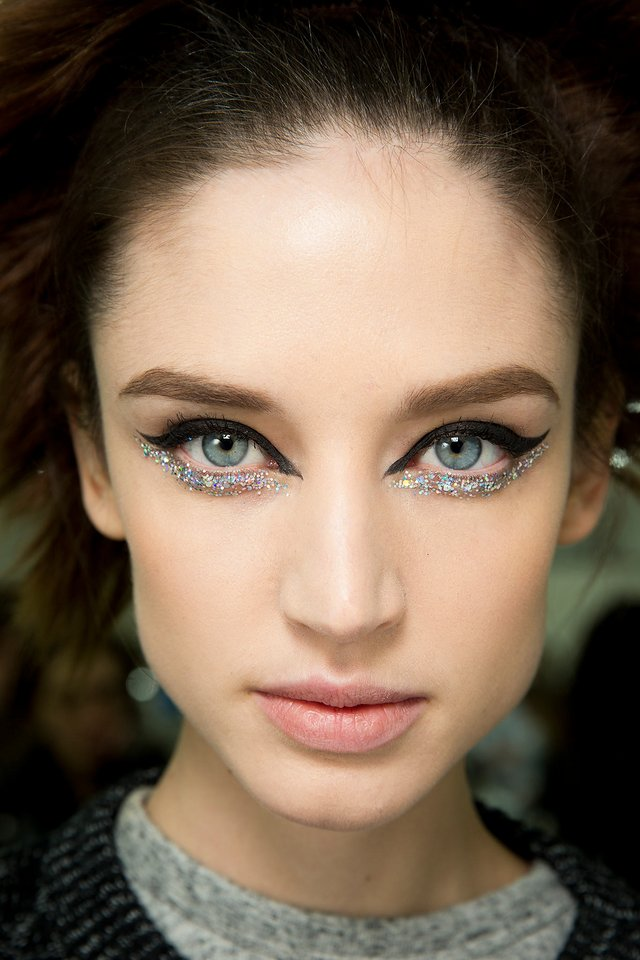 "GLITTER CAT A feline flick, as backstage pro Peter Philips noted at Chanel's Spring '14 Couture show, is ""chic and iconic,"" but holographic glitter makes a perfect wing feel ""relaxed and fresh."" To keep the shine from migrating to your cheeks over the course of the night, rim your lower lashes with a platinum liquid liner."