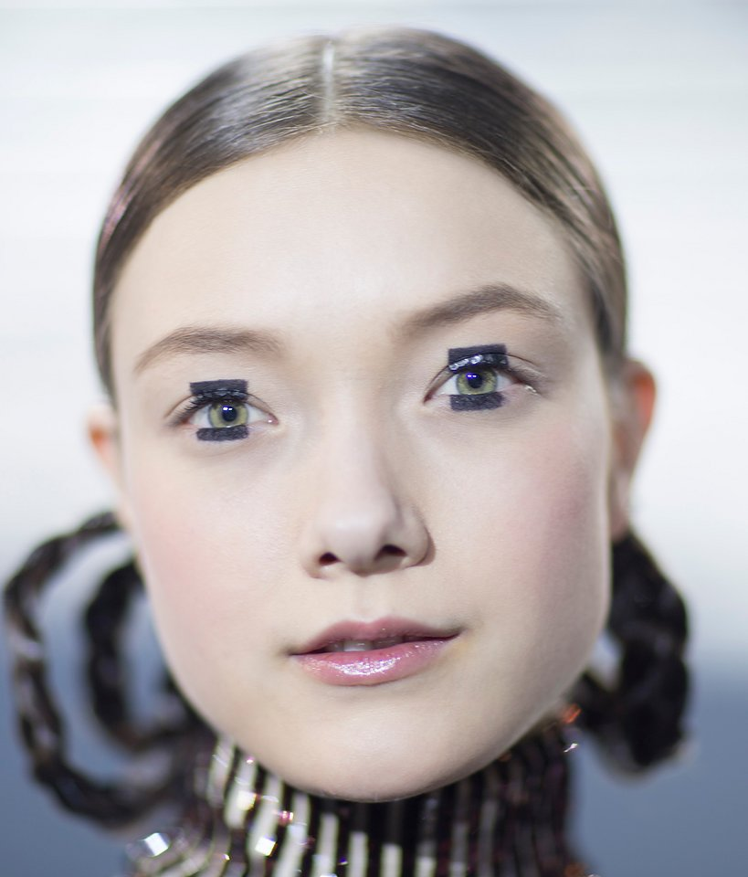 "ROBO GLITTER If you can't wear Dior's sequinned turtleneck under your cocktail dress, the next best thing is to re-create the ""electric kabuki"" look from the house's Pre-Fall '15 runway. Etch blocks above and below your iris with a felt-tip liner pen, then apply jumbo pieces of silver glitter inside the rectangular shape on your top lid. ""It catches the light when the eyes close, creating a pretty spectacular robotic glitter effect,"" Peter Philips said backstage."
